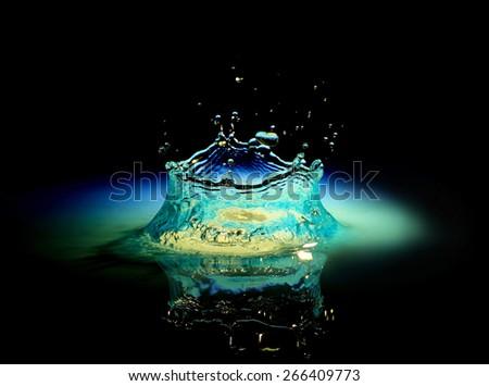 Water splash in black - stock photo