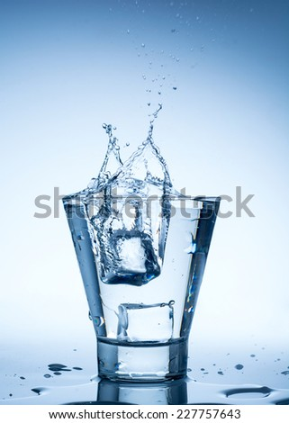water splash in glass isolated on white background - stock photo