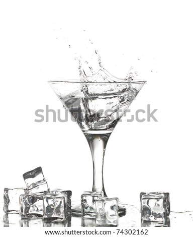 Water splash in martini glass and ice cubes - stock photo
