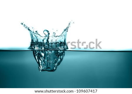 Water splash in white - stock photo