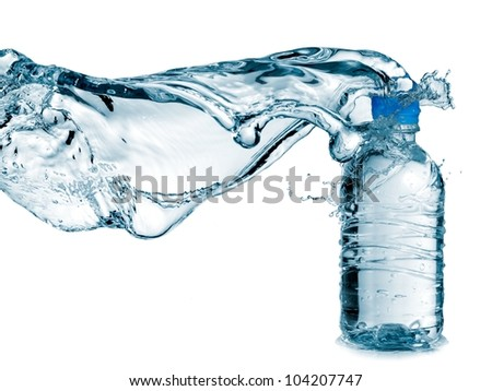 Water splash over a small plastic water bottle - stock photo