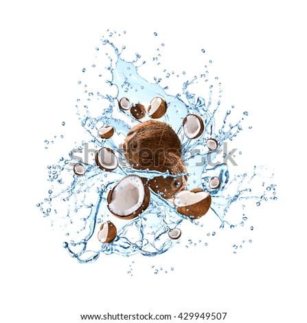 Water splash with fruits isolated on white background. Fresh coconut - stock photo