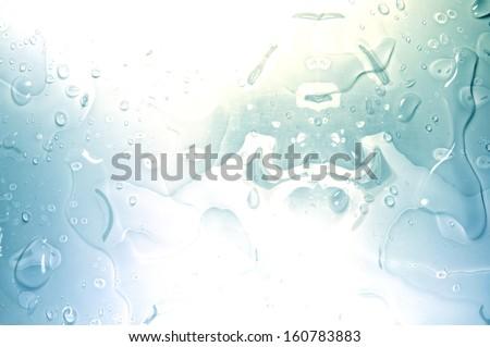 Water splashes isolated on blue background - stock photo