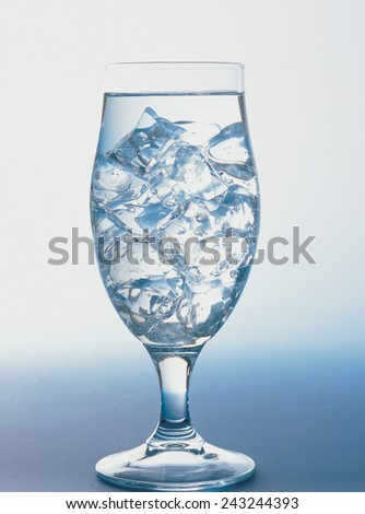 water splashing from glass isolated - stock photo