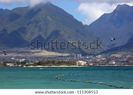 Water Sports in Hawaii with the West Maui Mountains in the distance - stock photo