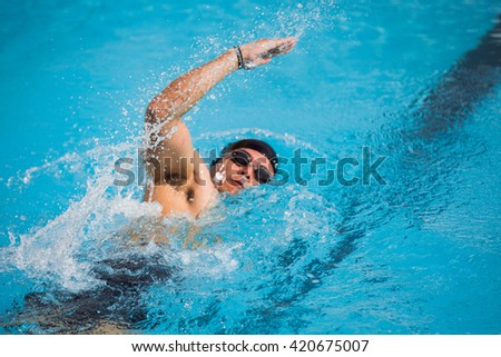 Water spread as a swimmer - stock photo