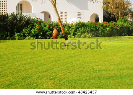 water sprinkler in a garden - stock photo