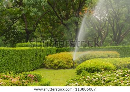 water sprinkler in garden - stock photo
