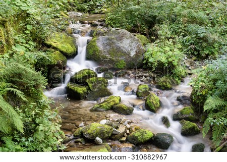 water stream on mountain river, Dolomites, Italy - stock photo