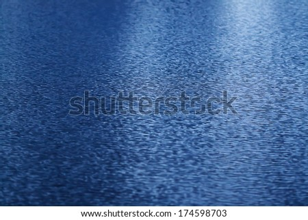 water surface of a sea in the evening - stock photo