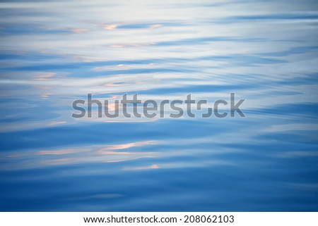 Water surface of the sea background. patch of light on the water. - stock photo