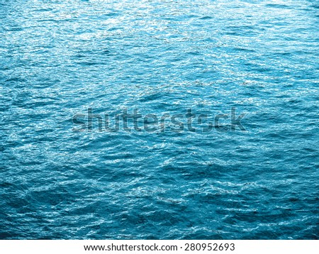 Water surface texture useful as a background - cool cold tone - stock photo
