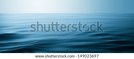 water surface with waves and ripples as background - stock photo