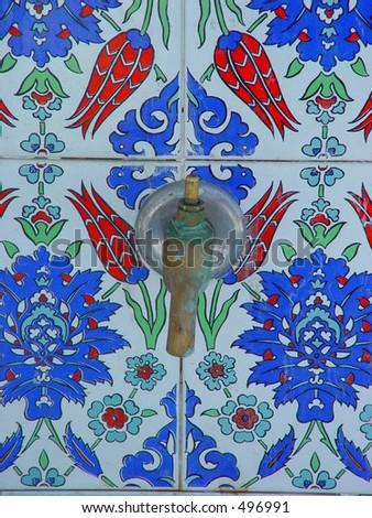 Water tab on Turkish tiles - stock photo