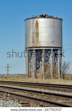 Water tank along a railroad - stock photo