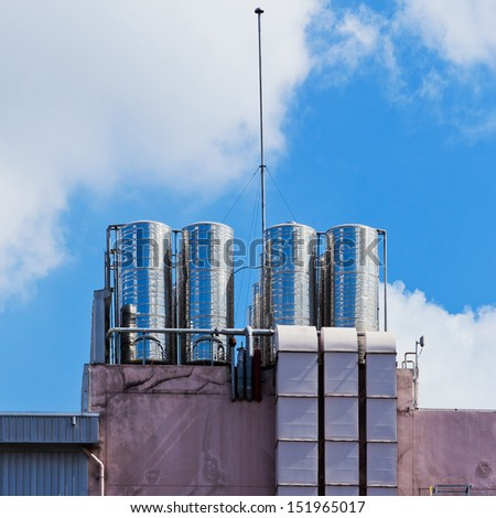 Water tank on high building. - stock photo