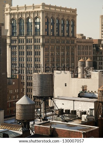 Water Tanks on Top of New York City Roofs - stock photo