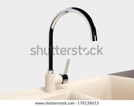 Water tap and sink in a modern kitchen - stock photo