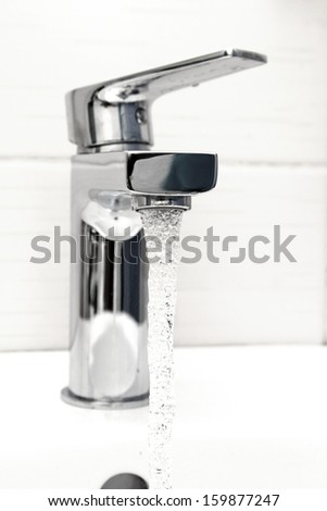 water tap with flowing water - stock photo