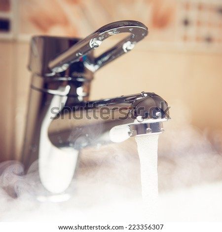 water tap with hot water steam - stock photo