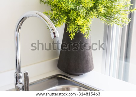 Water tap with sink in  modern kitchen. - stock photo
