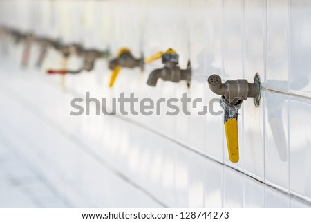 Water taps in a public school of Si Sa Ket, Thailand - stock photo
