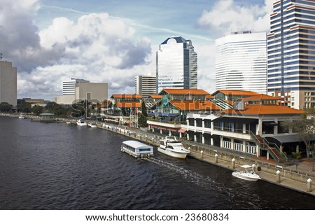 water taxi near the downtown Jacksonville Florida waterfront shopping and dining plaza - stock photo