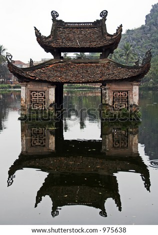 Water temple and its reflection - stock photo