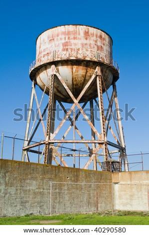 Water tower and prison wall, Alcatraz Penitentiary, Alcatraz Island, San Francisco Bay, California - stock photo