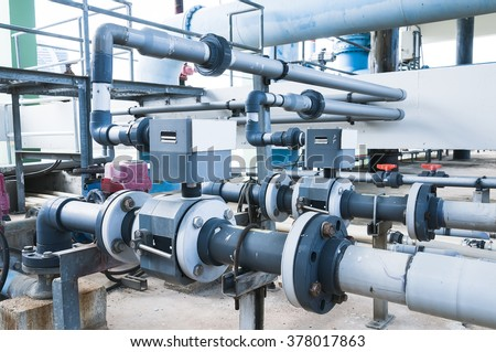 water treatment plant piping system - stock photo