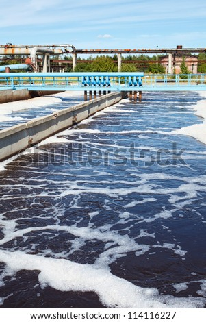 Water treatment tank with waste water - stock photo