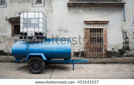 Water truck front cracked brick wall, Steel door stretch on the damaged concrete wall, cracked brick wall is background or texture - stock photo