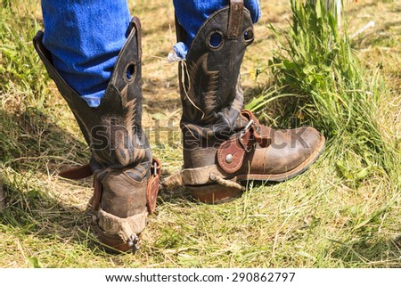 WATER VALLEY, CANADA - JUN 6 2015: Cowboy  in his special boot standing by in the the Water Valley Rodeo.This annual event is important for the rural as well as the sport loving community. - stock photo