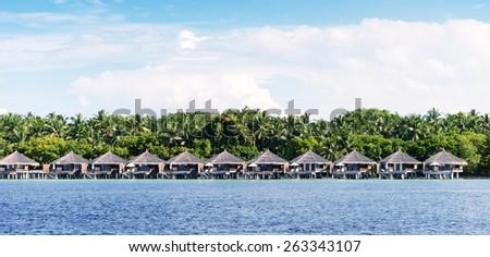 Water Villas in Maldivian Resort. - stock photo