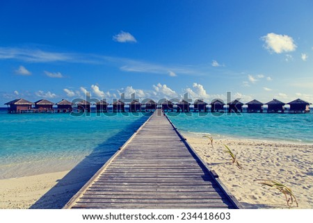 water villas in tropical sea resort - stock photo