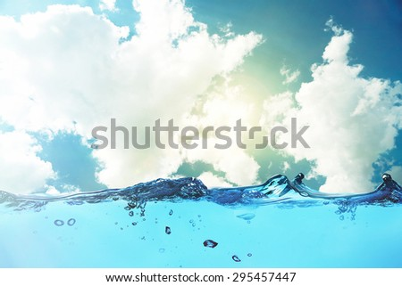 Water waves on sky background - stock photo