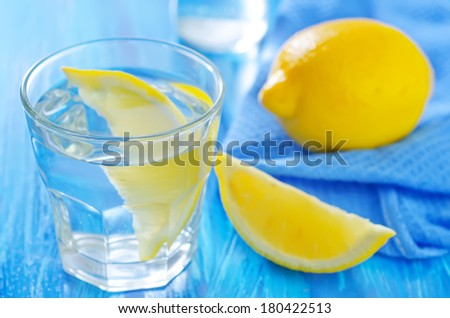 water with lemon - stock photo