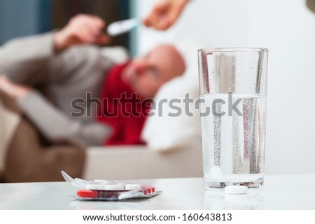 Water with soluble tablet for an ill patient - stock photo