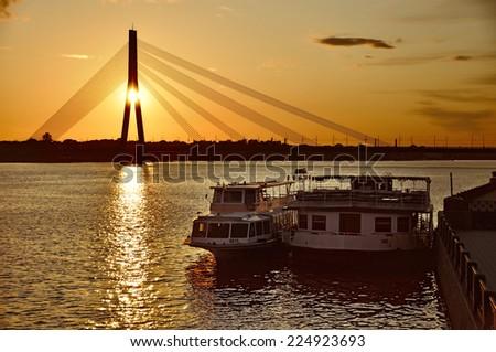 Waterbus on the river Daugava, Riga, Latvia - stock photo