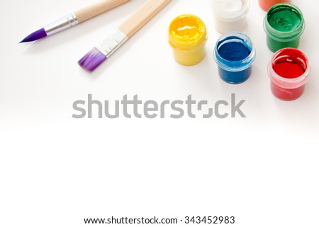 Watercolor paint and brushes isolated on white background. Art palette with paints. Colorful paint. - stock photo