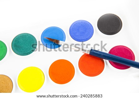 Watercolors and brushes isolated on the white background - stock photo