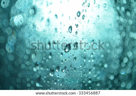 waterdrop in the blue bokeh background while outside is raining - stock photo