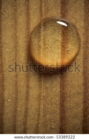 Waterdrop on a wooden surface. - stock photo