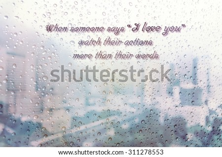 Waterdrops on a glass surface windows with i Love you qoutes on cityscape background - stock photo