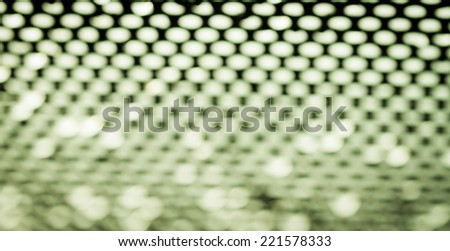 waterdrops under black steel grate in green tone - stock photo