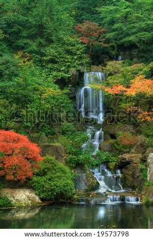 Waterfall and Autumn Foliage - stock photo
