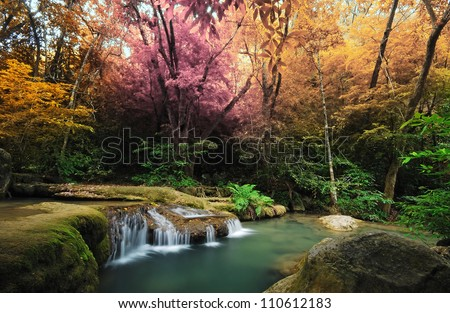 Waterfall and blue stream in the colorful forest spring season in Thailand - stock photo