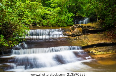 Waterfall and cascades on Carrick Creek, at Table Rock State Park, South Carolina. - stock photo