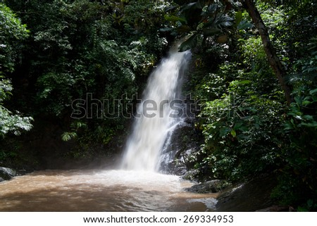 Waterfall and green rainforest in Langkawi, Malaysia. - stock photo