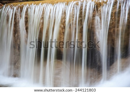 Waterfall and green stream in the forest Thailand - stock photo